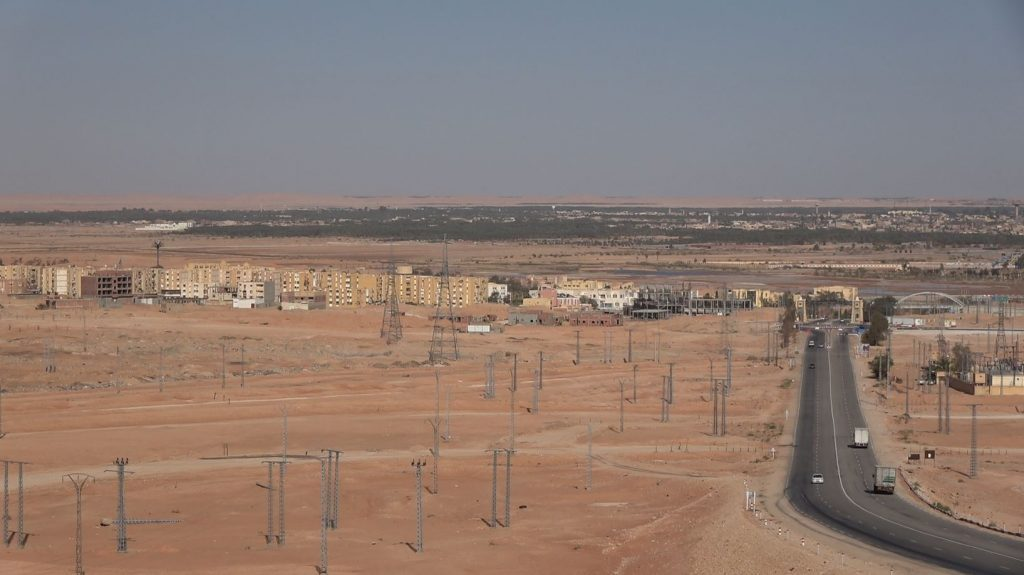 AL – New suburbs in front of the Ouargla oasis and the sandy dunes on the horizon